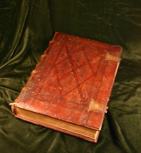 Shows fifteenth century leather tooled binding with copper clasps