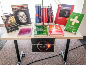 Health Sciences Library Book Display: Don't Get Left in the Dark. Read!