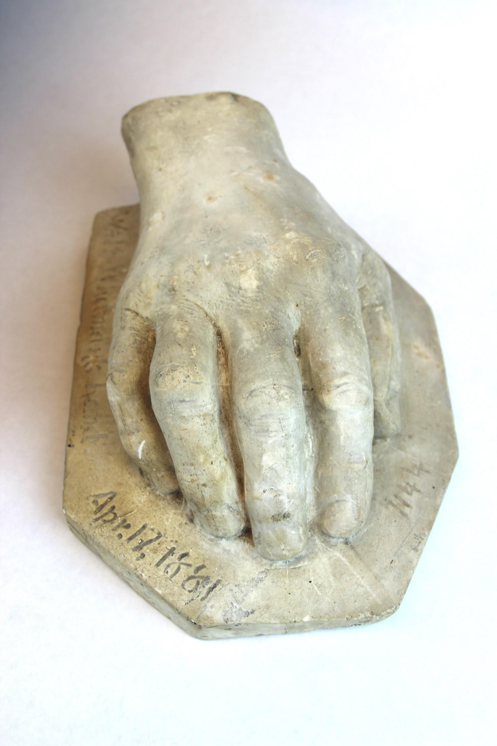 Plaster cast of Walt Whitman's hand.