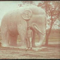 Hiller 09-063: Man with elephant statue on Elephant Road in Ming Xiaoling Mausoleum